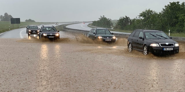 Cars drive in heavy rain on the partially flooded Autobahn in Wieselrieth, Germany, June 14. Heavy storms over the weekend caused numerous floods in the district of Neustadt an der Waldnaab.