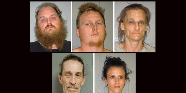 This combination of undated booking photos from the Shenandoah County (Virginia) Sheriff's Office shows from left to right, Donny Salyers, Dennis Salyers, Farrah Salyers, Christopher Sharp and Amanda Salyers. (Shenandoah County Sheriff's Office via AP)