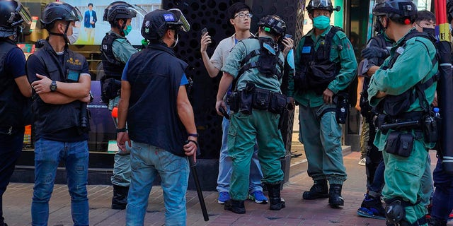 Police detain a person during a pro-democracy rally supporting human rights and to protest against Beijing's national security law in Hong Kong on Sunday. (AP Photo/Vincent Yu)