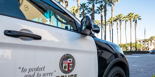 Close-up on the insignia and slogan of an LAPD vehicle. (iStock)