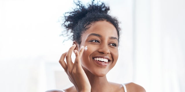 Moisturizing creams can improve the skin barrier and minimize irritation from face masks, experts say. (iStock)