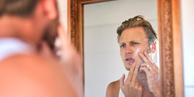 For those prone to acne, experts generally recommend products containing salicylic acid or benzoyl peroxide (at a concentration of 5.5 percent or less). (iStock)