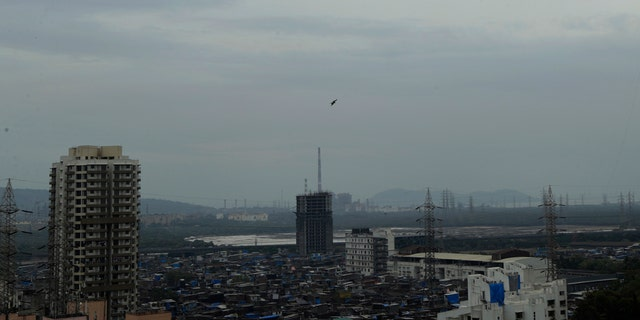 Dark clouds gather over the skyline in Mumbai India Tuesday
