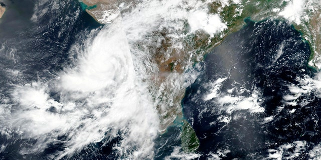 This June 2, satellite image released by NASA shows Cyclone Nisarga roaring toward the western coast of India.