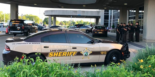Lake County Sheriff's squad cars are parked outside of Community Hospital in Munster, Ind., Tuesday, June 16, as a fatal shooting investigation is conducted. (Lucas Gonzalez/The Times via AP)