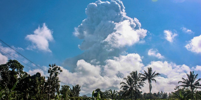Mount Merapi spews volcanic materials during an eruption as seen from Sleman, Indonesia, Sunday, June 21, 2020.