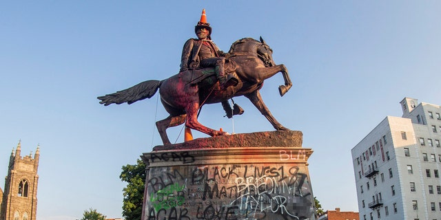 Traffic cones and a rope remain on the statue of Confederate General J.E.B. Stuart the morning after protesters against racial inequality attempted to topple it in Richmond, Virginia, U.S., June 22, 2020.