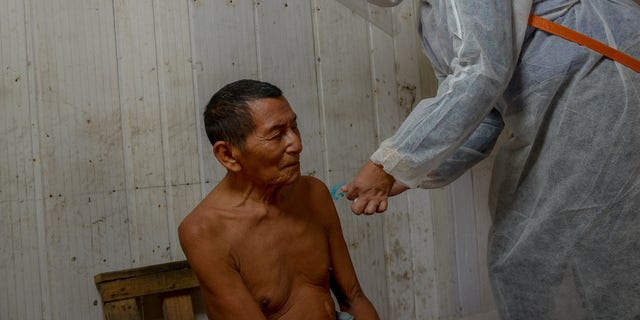 A Kokama native being examined by doctors in his tribe.