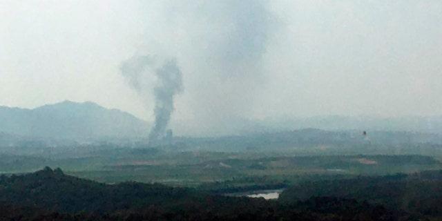 Smoke rises in the North Korean border town of Kaesong, seen from Paju, South Korea, Tuesday, June 16, 2020. South Korea says that North Korea has exploded an inter-Korean liaison office building just north of the tense Korean border. (Yonhap via AP)