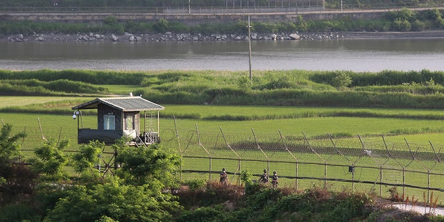 South Korean army soldiers patrol along the barbed-wire fence in Paju, South Korea, near the border with North Korea on June 15, 2020. (AP Photo/Ahn Young-joon) - File