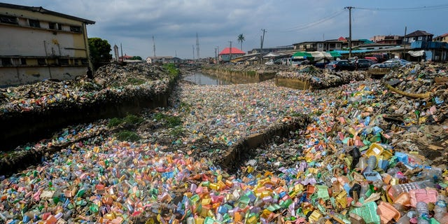 Garbage piles cover fields after heavy rainfall in Lagos, Nigeria on June 7.