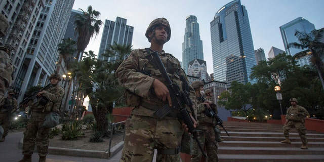Members of California National Guard stand guard in Pershing Square, Sunday, May 31, 2020, in Los Angeles.