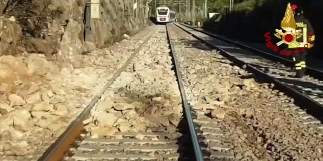 A commuter train in Italy derailed after striking boulders on the tracks after a landslide on Monday.
