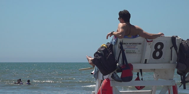 Lifeguards are learning new ways to perform rescues in order to socially distance as much as possible.
