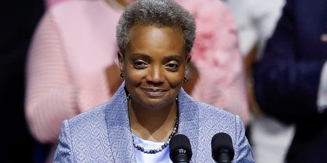 Lori Lightfoot speaks after being sworn in as Chicago's 56th mayor by Judge Susan E. Cox during an inauguration ceremony at Wintrust Arena in Chicago last year. (REUTERS/Kamil Krzaczynski)