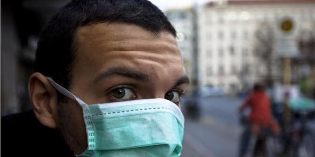 Early face mask adoption linked to modest infection rates.