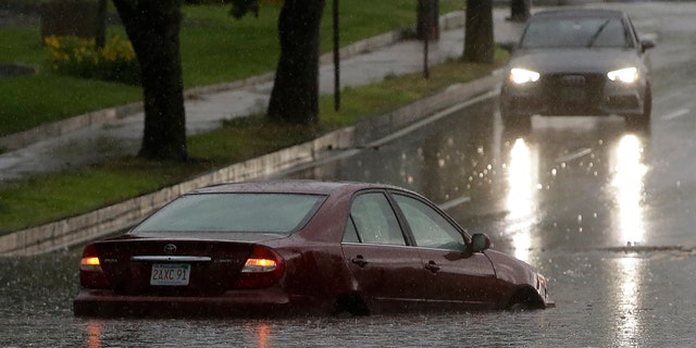 Heavy rains resulted in flooding on many streets in areas south of Boston, Sunday.