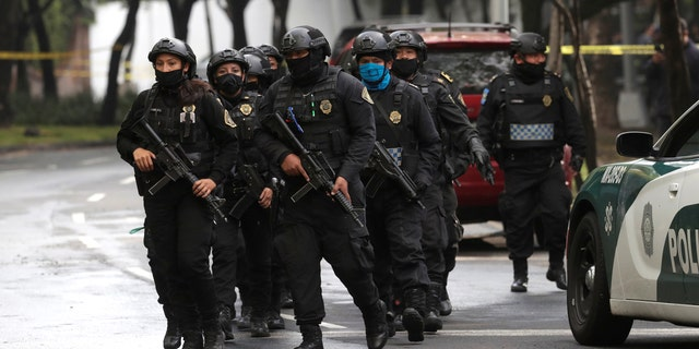 Police officers arrive at the area where a shooting took place in Mexico City Mexico