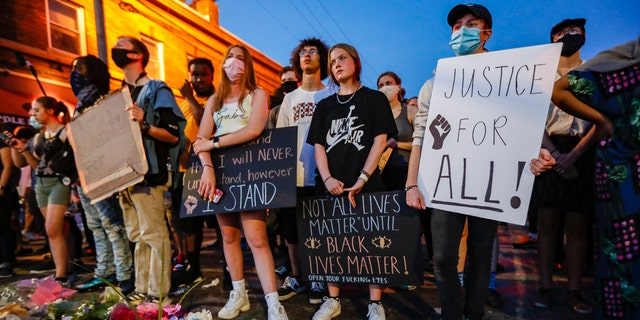 Protesters gather at a memorial for George Floyd where he died outside Cup Foods on East 38th Street and Chicago Avenue, Monday, June 1, 2020, in Minneapolis. Protests continued following the death of George Floyd, who died after being restrained by Minneapolis police officers on May 25. (AP Photo/John Minchillo)