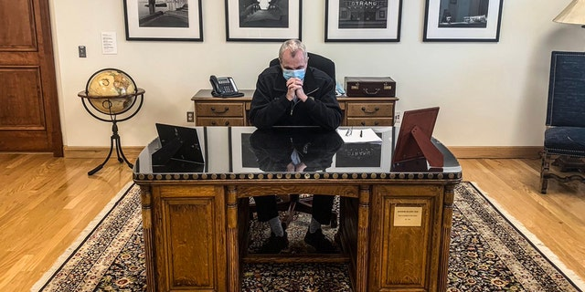 Murphy came under fire for using the historic furniture after he tweeted a photo of himself聽paying tribute to George Floyd from behind the desk engraved with Wilson鈥檚 name.