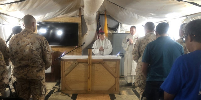 Archbishop Timothy Broglio, Archbishop of U.S. Military Services, celebrates Mass with U.S. and Italian service members deployed to Nigerien Air Base 101 in Niamey, Niger, Nov. 3, 2019. (Courtesy Photo)