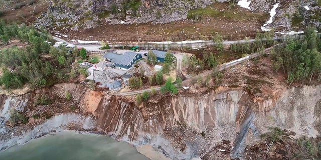 Rocks continued to fall into the bay following the powerful landslide. (Anders Bjordal/NTB Scanpix via AP)