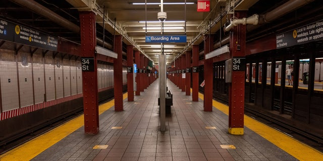 A nearly empty subway station platform is seen in Herald Square's subway station on the first day of the city's reopening.