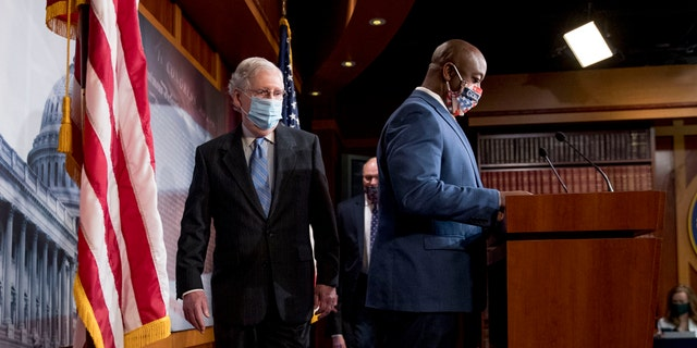 Senate Majority Leader Mitch McConnell of Ky., left, and Sen. Tim Scott, R-S.C., right, arrive at a news conference to announce a Republican police reform bill on Capitol Hill, Wednesday, June 17, 2020, in Washington. (AP Photo/Andrew Harnik)