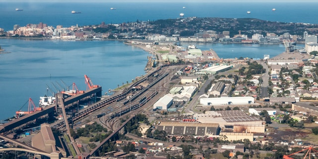 The Port of Newcastle and coal loading facilities at Carrington. Newcastle is the largest coal export port in the world loading freights with black coal. (iStock)