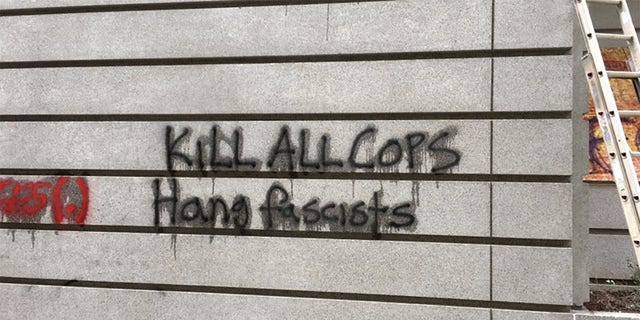 "Anti-cop graffiti reading ""Kill All Cops"" was found on a Portland building during a demonstration that turned violent on Saturday, police said."