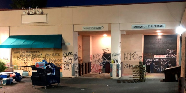 This Friday, June 26, 2020, photo released by the Portland Police Department shows damage after protests calling for an end to racial injustice and accountability for police in Portland, Ore. Some protesters set fire to a police precinct, vandalized businesses and tried to barricade police officers inside their station during a demonstration early Friday morning that ended with law enforcement using tear gas to disperse the crowd, authorities said. (Portland Police Department via AP)