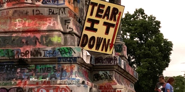 The base of the Gen. Robert E. Lee statute in Richmond, Va. is covered in graffiti.