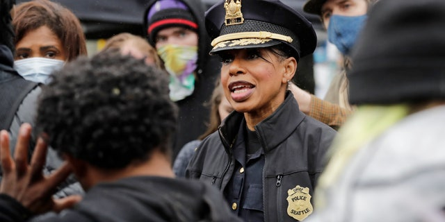 Seattle police Chief Carmen Best talks with activists in an undated photo. (Associated Press)