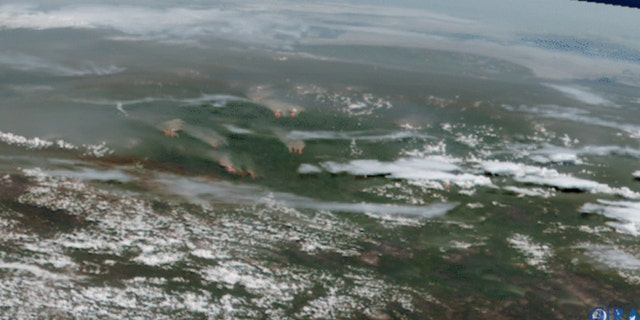 Smoke and flames from active fires burning across Sibera can be seen on this satellite imagery from June 21.