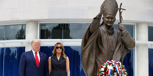 President Donald Trump and first lady Melania Trump visit Saint John Paul II National Shrine, Tuesday, June 2, 2020, in Washington. (Associated Press)