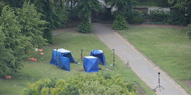 An aerial view showing blue police tents Sunday in Forbury Gardens, the scene of a stabbing attack in Reading on Saturday. (Jonathan Brady/PA via AP)