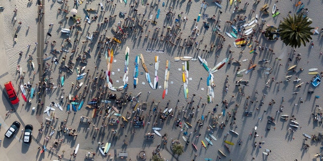 California surfers spell out 'unity' with boards before staging paddle out in George Floyd's memory 56