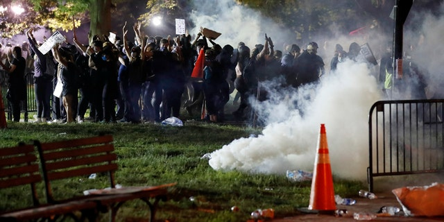 Tear gas billows as demonstrators gather in Lafayette Park to protest the death of George Floyd, Sunday, May 31, 2020, near the White House in Washington.聽 (AP Photo/Alex Brandon)