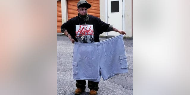 Jen Costa with the shorts she wore prior to her dramatic weight loss. (SWNS)