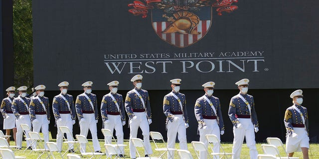 United States Military Academy graduating cadets wearing face masks march to their socially-distanced seating during commencement ceremonies, Saturday, June 13, 2020, in West Point, N.Y. (AP Photo/John Minchillo, Pool)