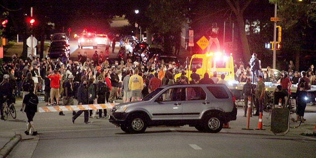Protesters block traffic at an intersection an intersection near Capitol Square in Madison on Tuesday. (Emily Hamer/Wisconsin State Journal via AP)