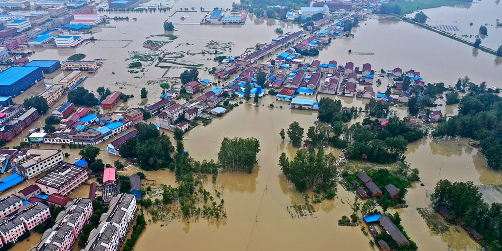 China flooding leaves thousands trapped after levees fail, another ...