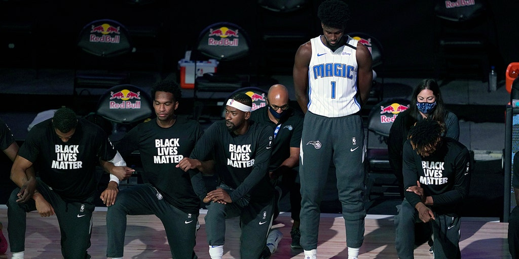 Magic's Jonathan Isaac stands for national anthem as teammates, opponents kneel