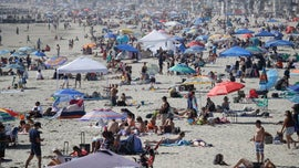 Thousands flock to beaches for holiday weekend as COVID rate soars, but death rate remains stable