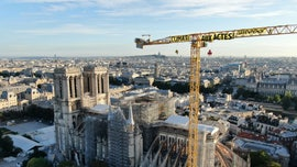 Greenpeace activists hang banner on Notre Dame Cathedral crane