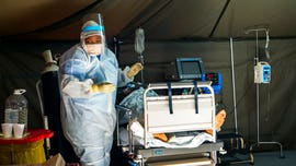 South Africa reimposes liquor ban amid coronavirus surge to free up hospital space