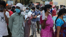 India sees lockdowns reimposed as coronavirus surge nears 1 million cases
