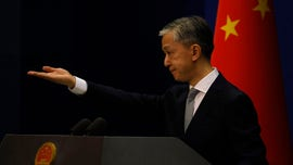 China vows retaliation if US continues 'hostile actions' against journalists