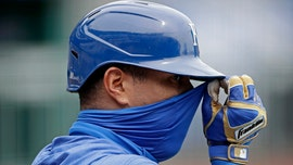 Opening day amid virus: Masked men, empty parks, odd sounds