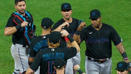 Virus-stricken Marlins resume season with 18 new players